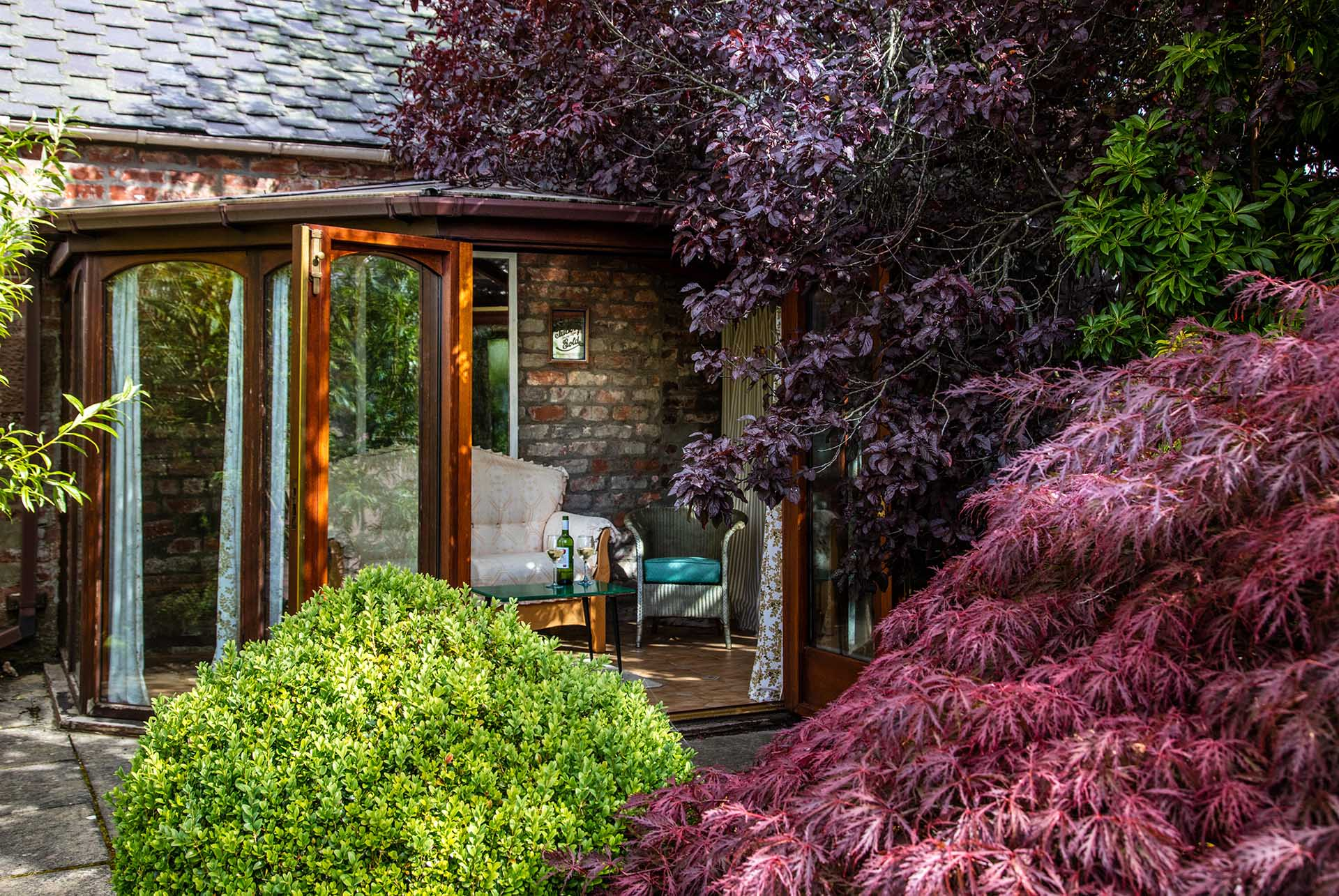 The summerhouse provides a quiet retreat.
